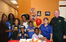 FCSO Partners with Kid Wish Network and Dunkin Donuts to Grant Wish of Palm Coast Boy Living with Cerebral Palsy